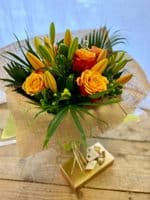 Lily and Rose Vase arrangement includes Chocolates